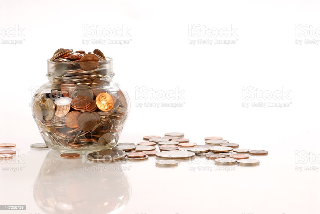 coins in the jar. stock photo