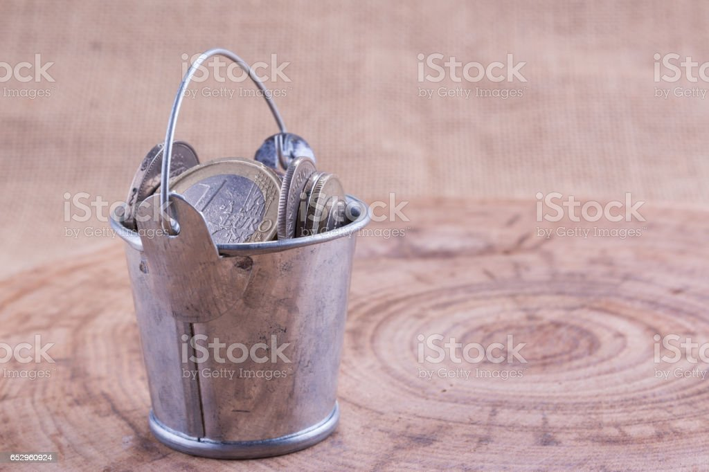Coins in the metal bucket stock photo
