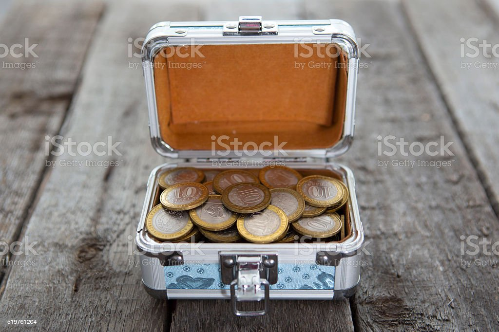 Coins money in small box on table. Ruble. stock photo