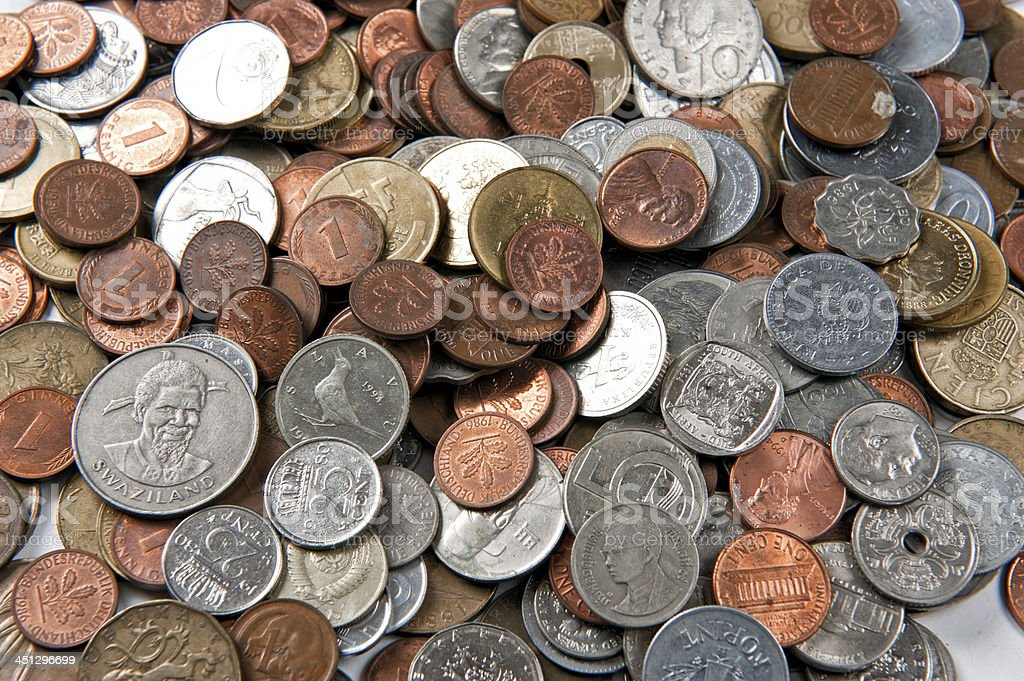 Coins of different currencies stock photo