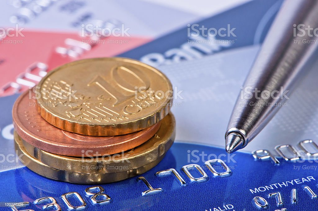Coins of eurocents, credit cards and pen. stock photo