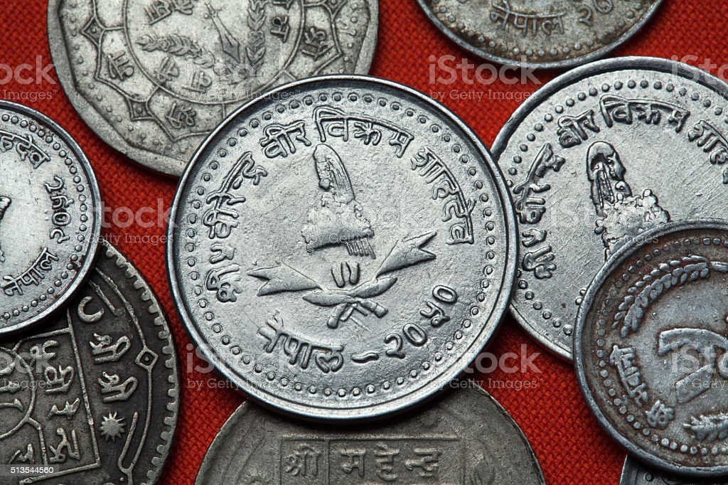 Coins of Nepal. Nepalese royal crown stock photo