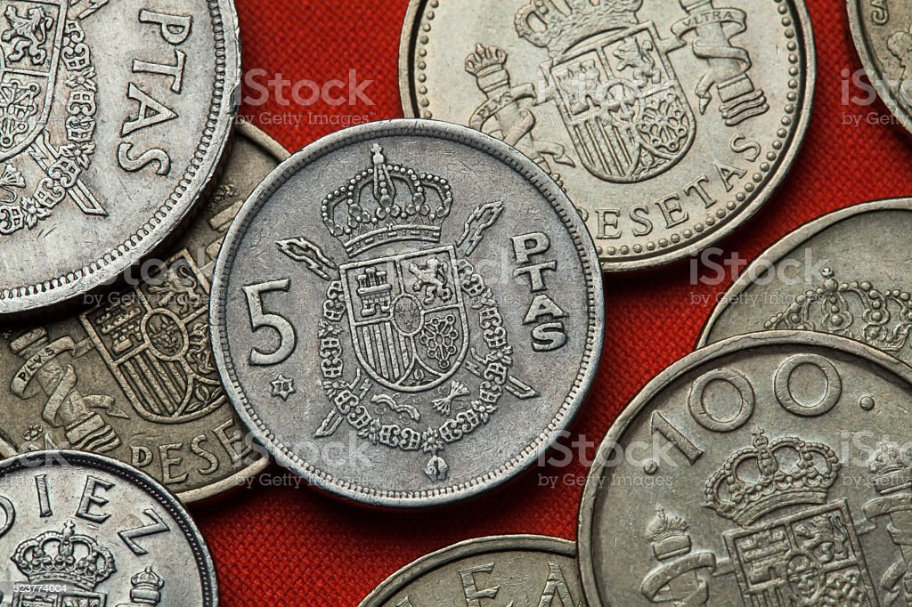 Coins of Spain. Spanish national emblem stock photo