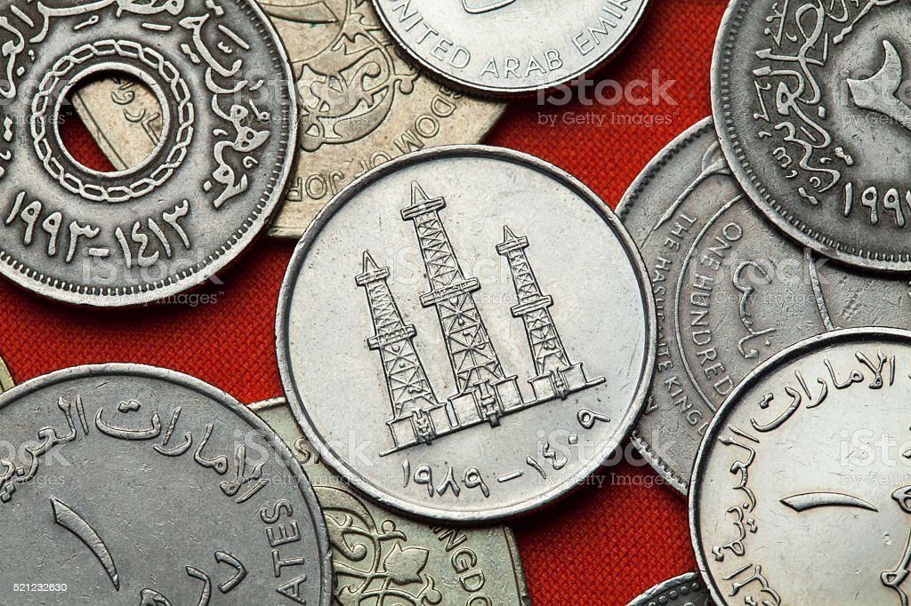 Coins of the United Arab Emirates. Oil derricks stock photo