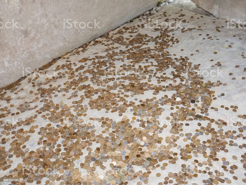 Coins on a concrete floor stock photo