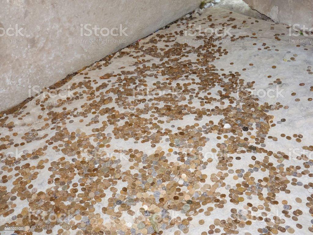 Coins on a concrete floor stock photo
