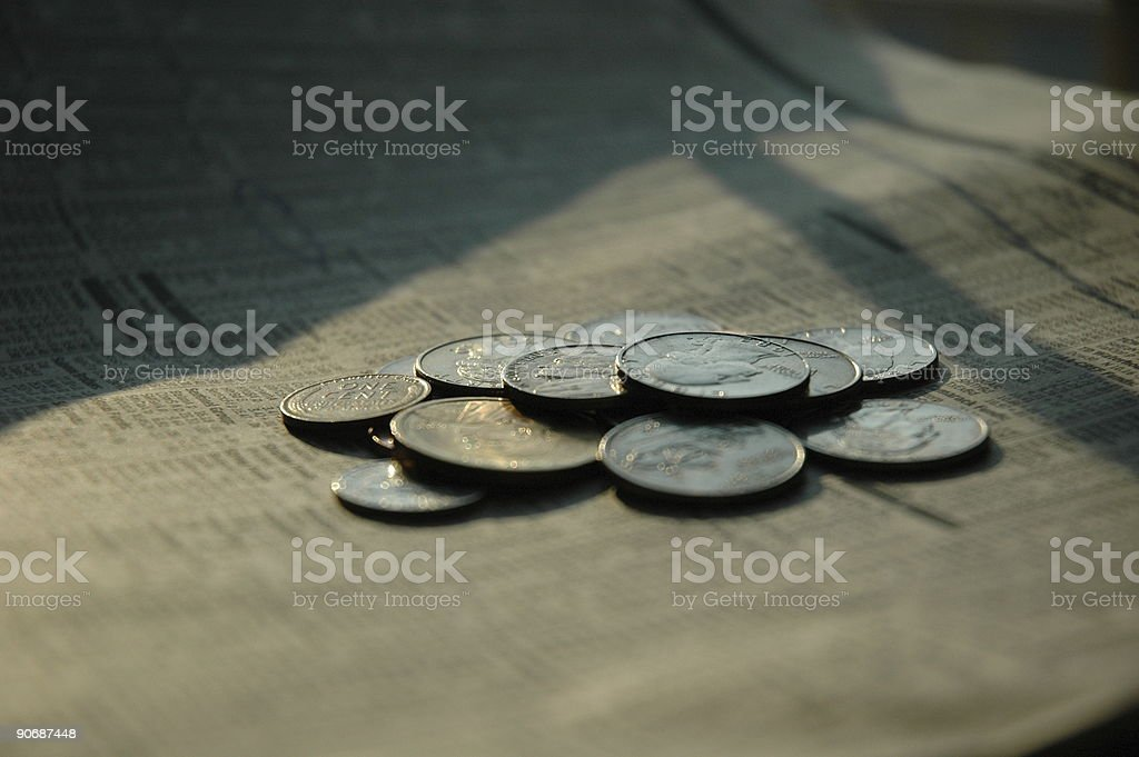 Coins on finance pages - Extremely shallow DOF royalty-free stock photo