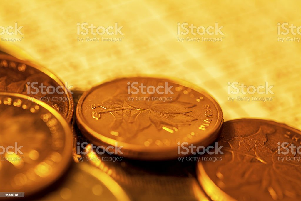 Coins on financial reporting royalty-free stock photo