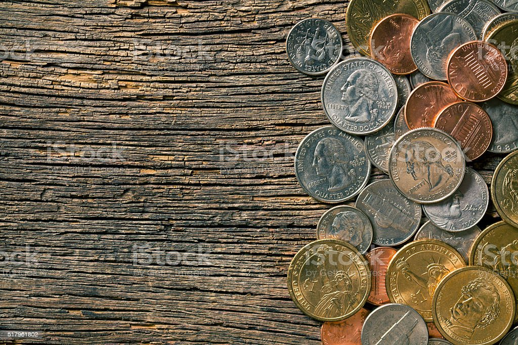U.S. coins on old wooden background stock photo