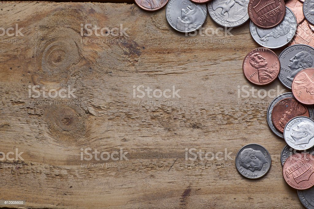 U.S. coins on old wooden background . stock photo