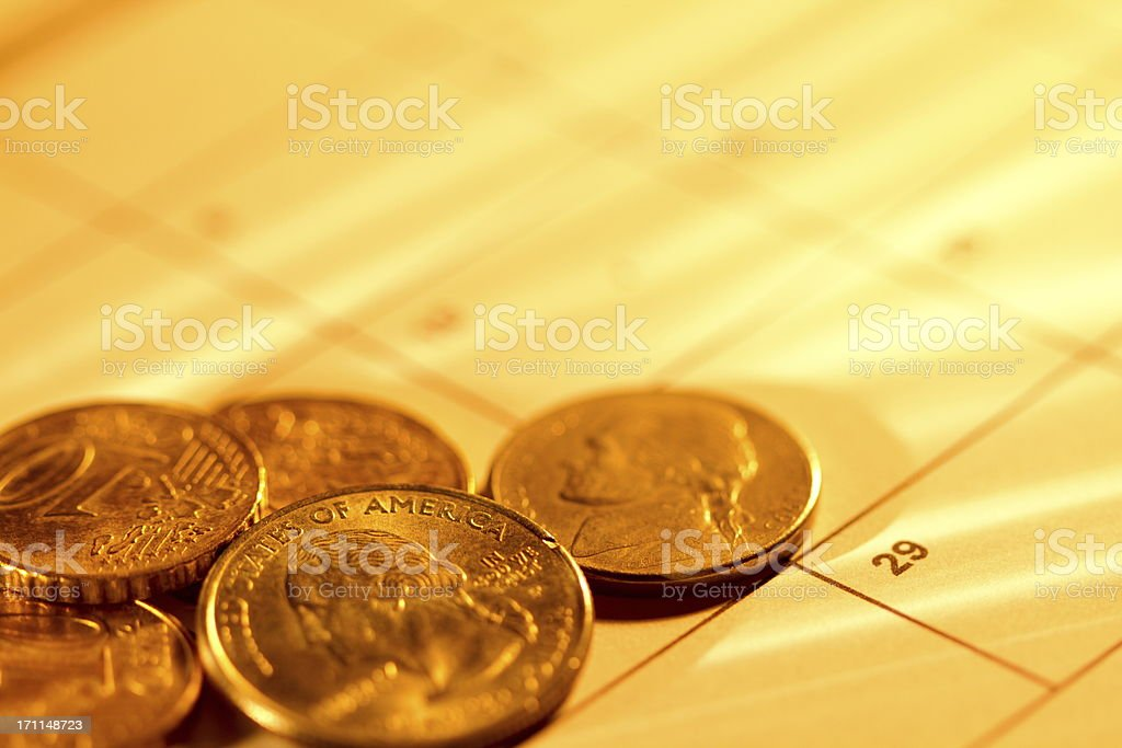 Coins on the calendar royalty-free stock photo