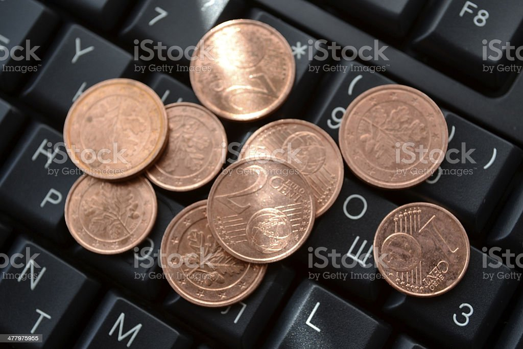 Coins on the keyboard royalty-free stock photo