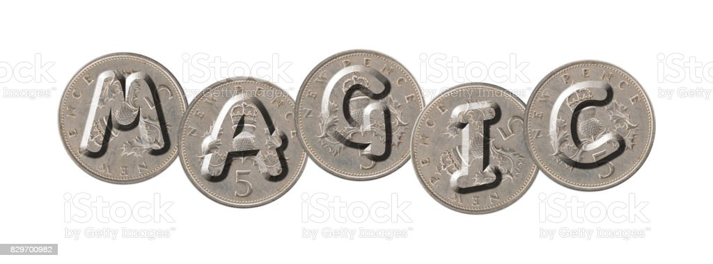 MAGIC – Coins on white background stock photo