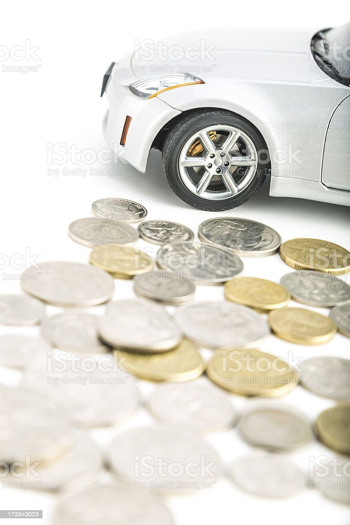 Coins on white with car royalty-free stock photo