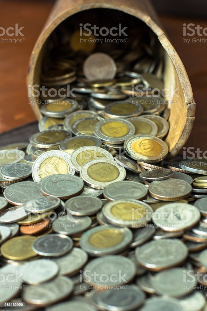 Coins Overflowing A Bamboo Flask stock photo