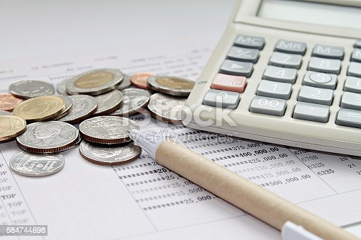 Coins Pen And Calculator On Savings Account Passbook stock photo – Savings Account Calculator