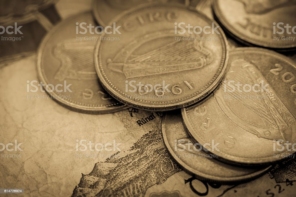 Coins resting on a bank note (Ireland) stock photo