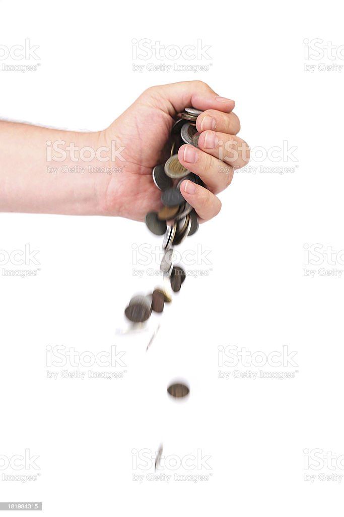 Coins spilling out of hand. stock photo