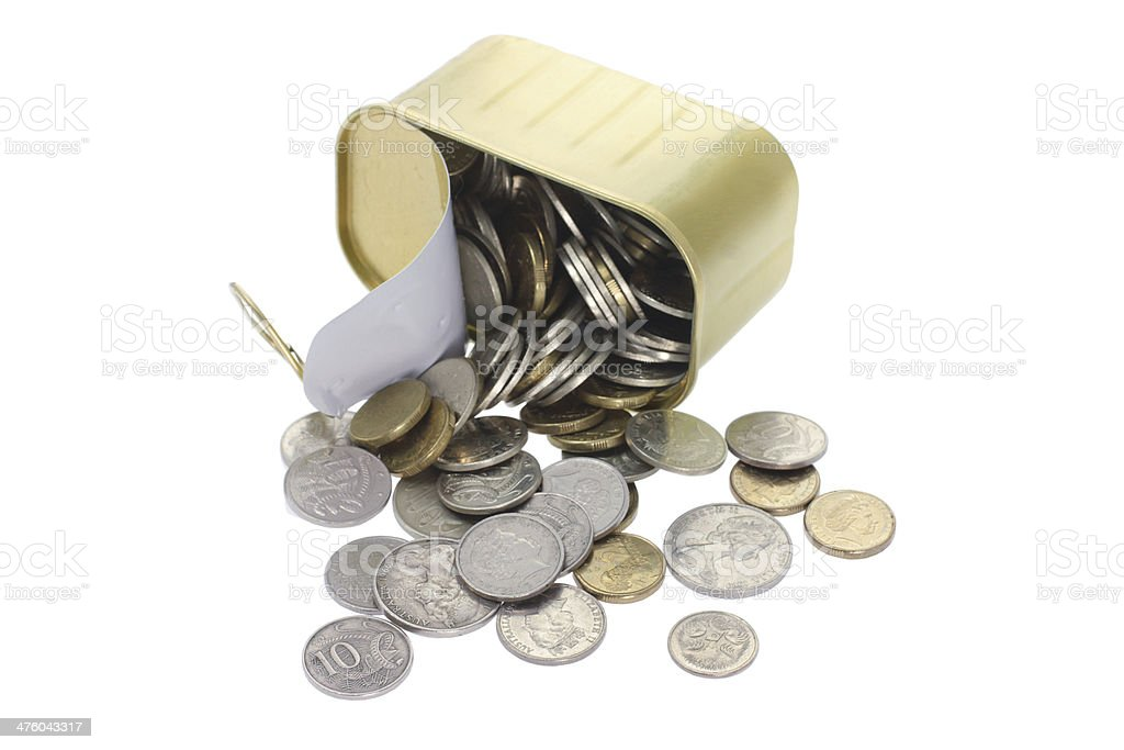 Coins Spilling Out of Tin Can royalty-free stock photo