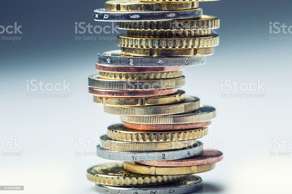 Coins stacked on each other in different positions. Money concept stock photo