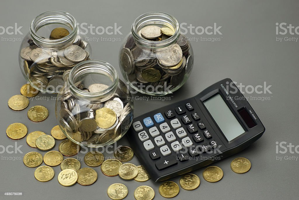 coins with calculator. financial concept stock photo