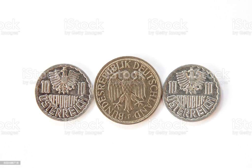 Coins with Eagles - obsolete currency from Austria and Germany stock photo