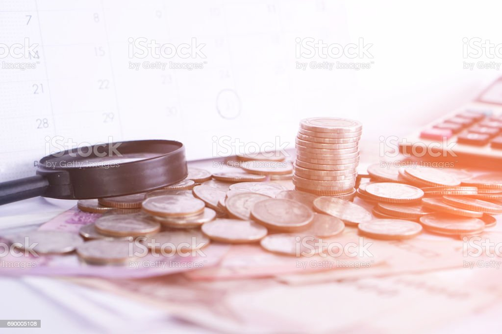 coins,money,calculator on wooden desk business investment background stock photo