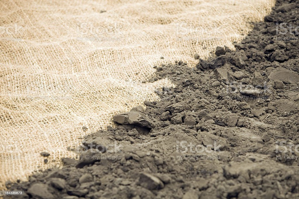 Coir Erosion Blanket and Dirt for Landscaping stock photo