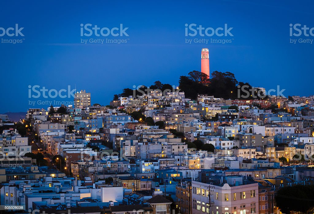 Coit tower and houses in San Francisco at night stock photo