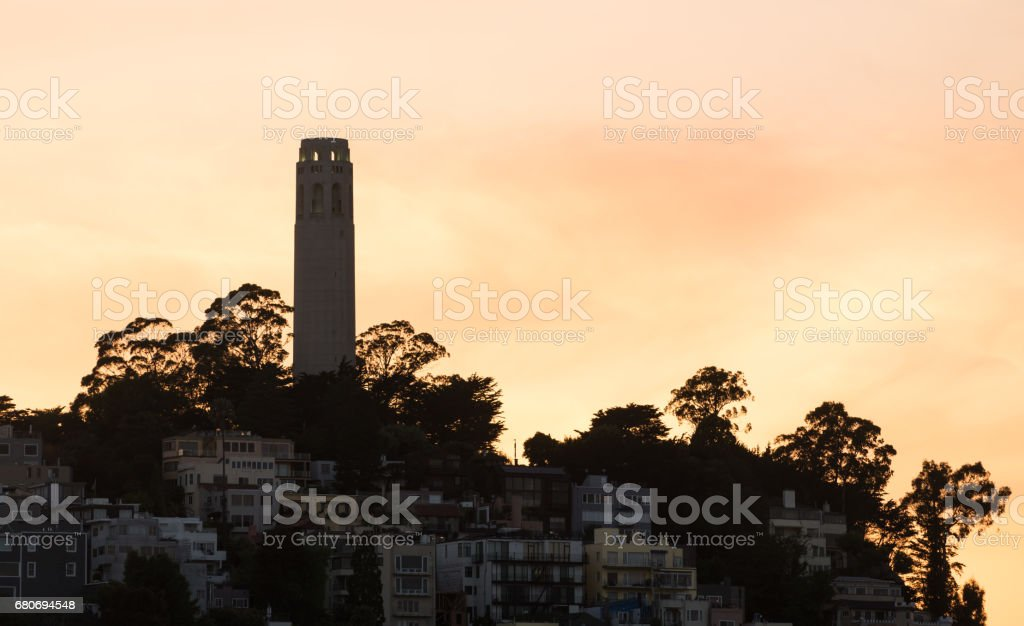 Coit tower at sunset in the downtown area of San Francisco stock photo