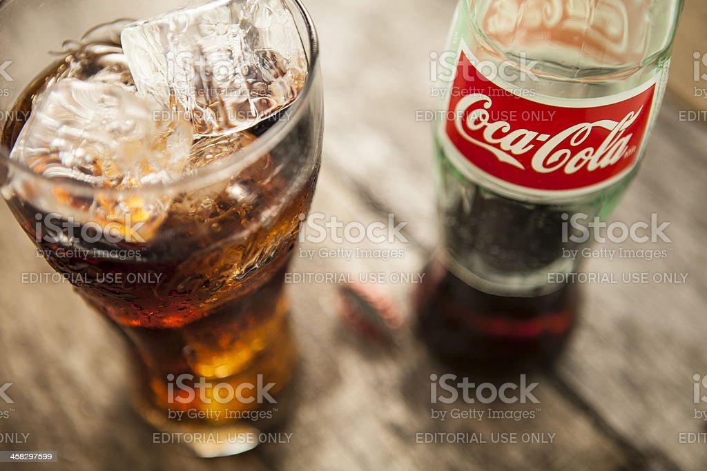 Coke Bottle And Glass stock photo