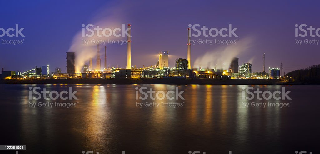 Coking Plant By River At Night stock photo