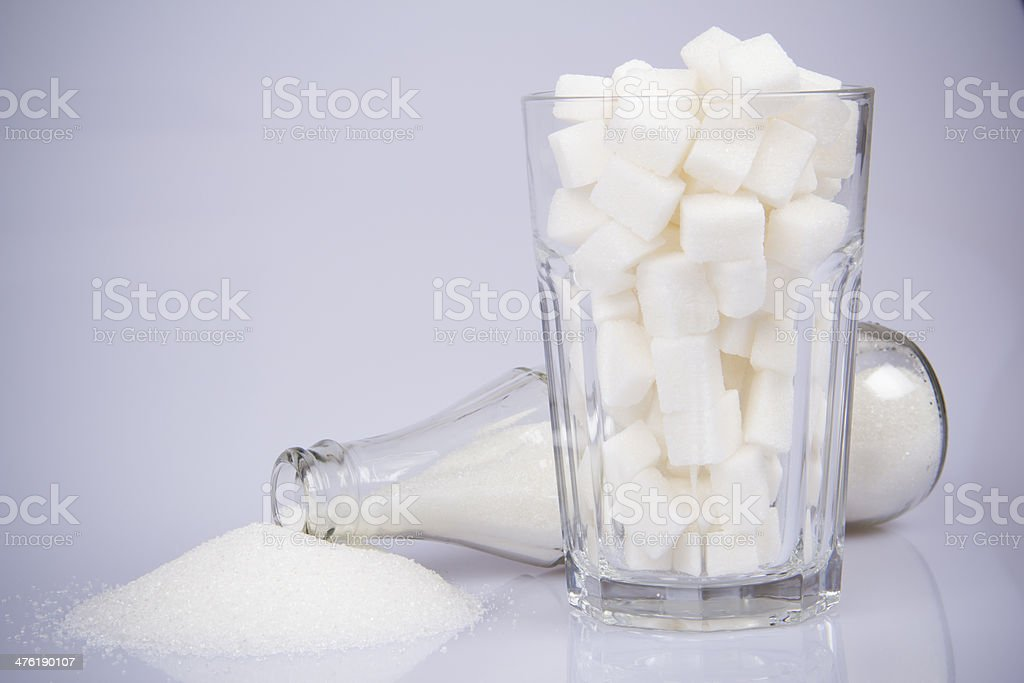 Cola Bottle with Sugar and Sugar Cubes-three stock photo