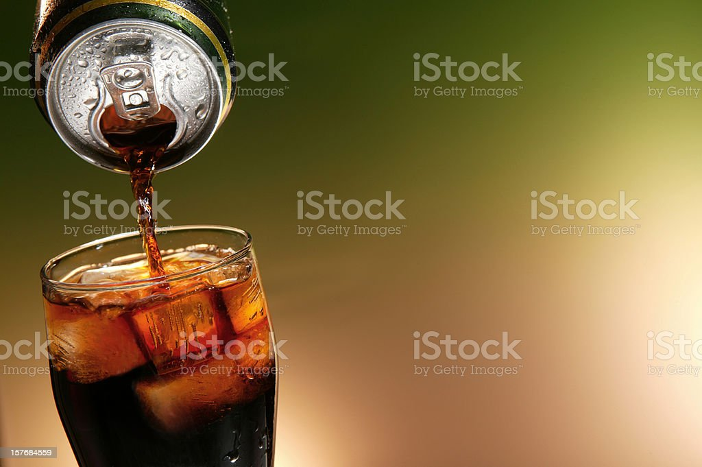 cola can pouring in a glass stock photo