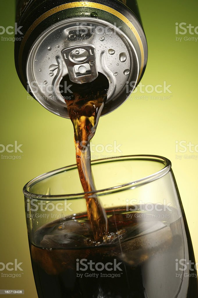 cola can pouring in a glass royalty-free stock photo