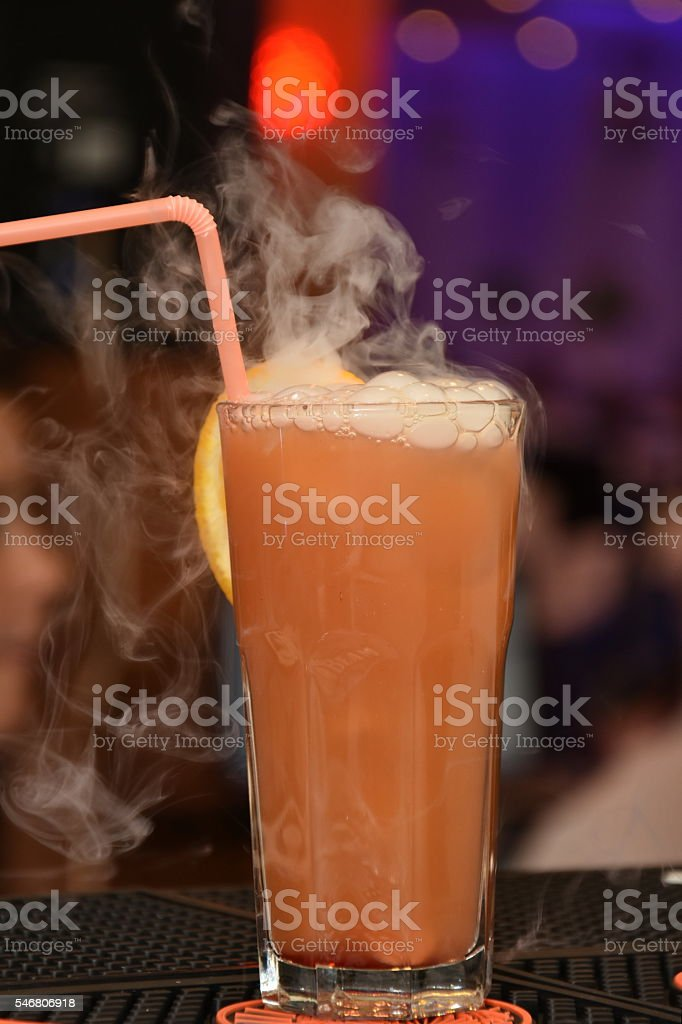 cola cocktail with peach  and dry ice stock photo