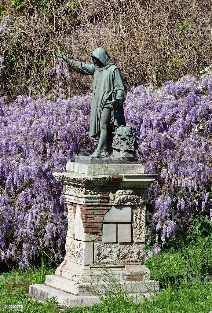 Cola di Rienzo monument among flowers stock photo