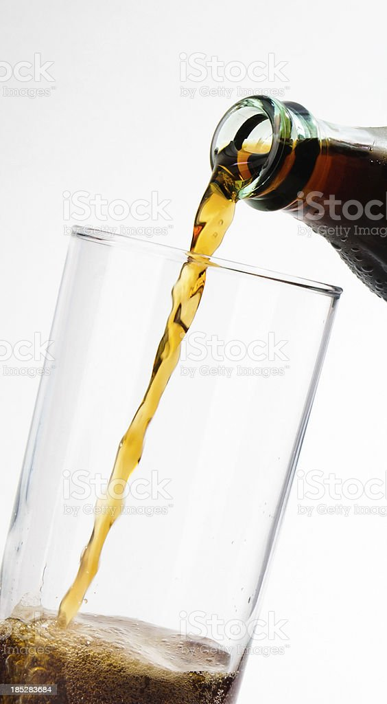 Cola pouring in a glass royalty-free stock photo