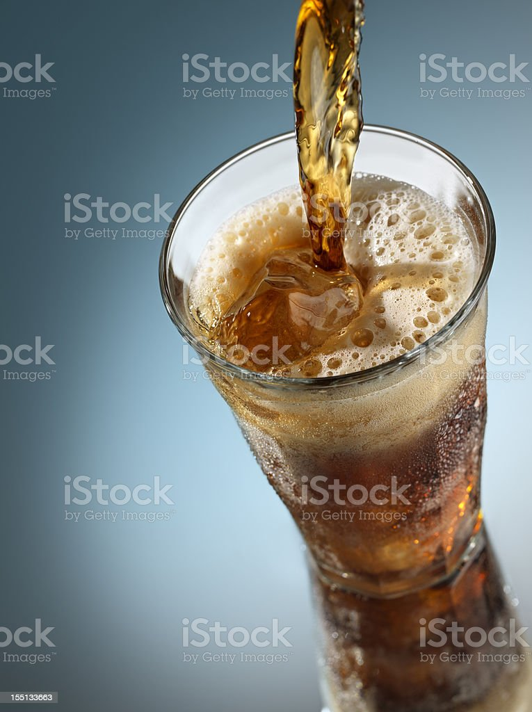 Cola pouring over Ice royalty-free stock photo