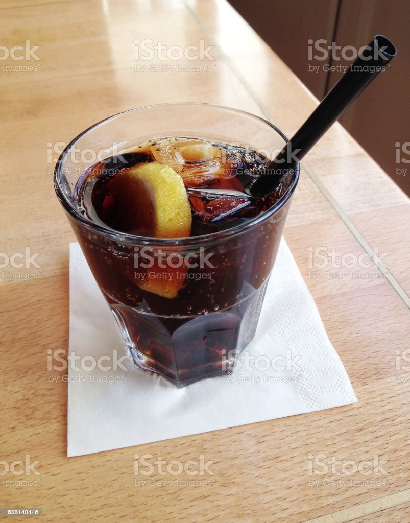 cola with lemon slice and ice cubes stock photo