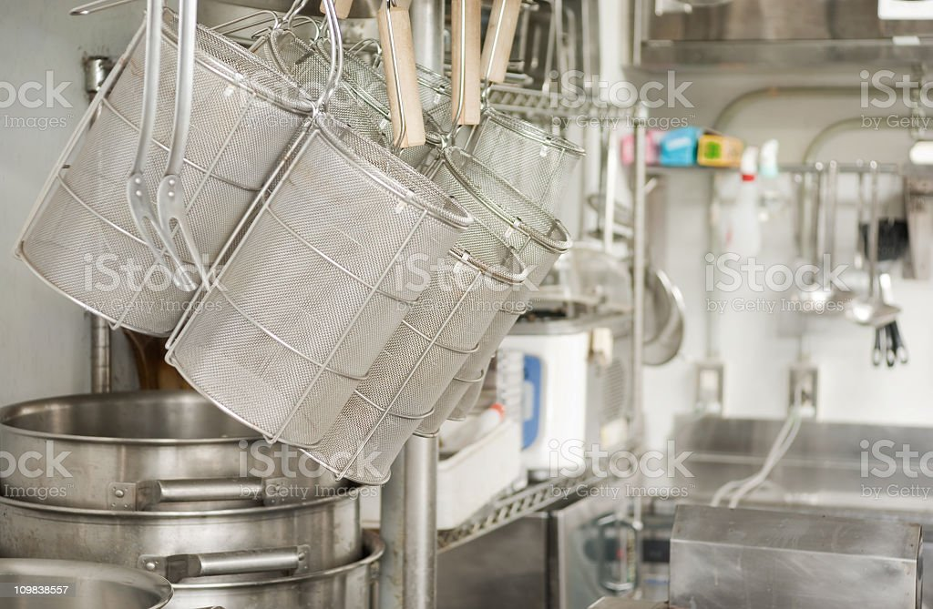 Colanders and kitchen utensils at a restaurant royalty-free stock photo