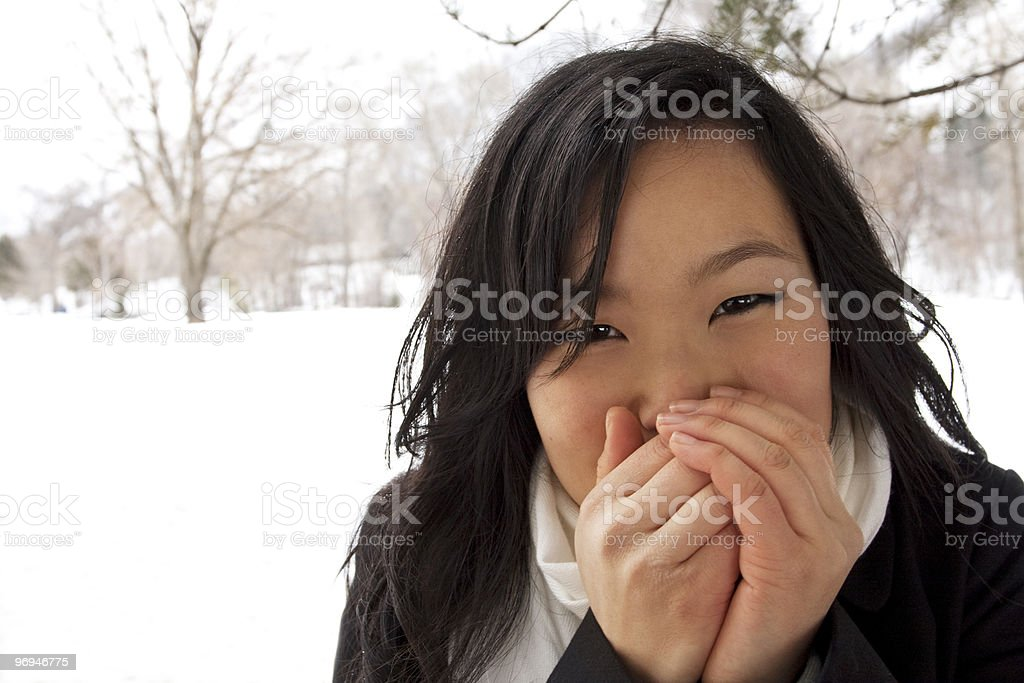 Cold and Freezing Asian Female stock photo
