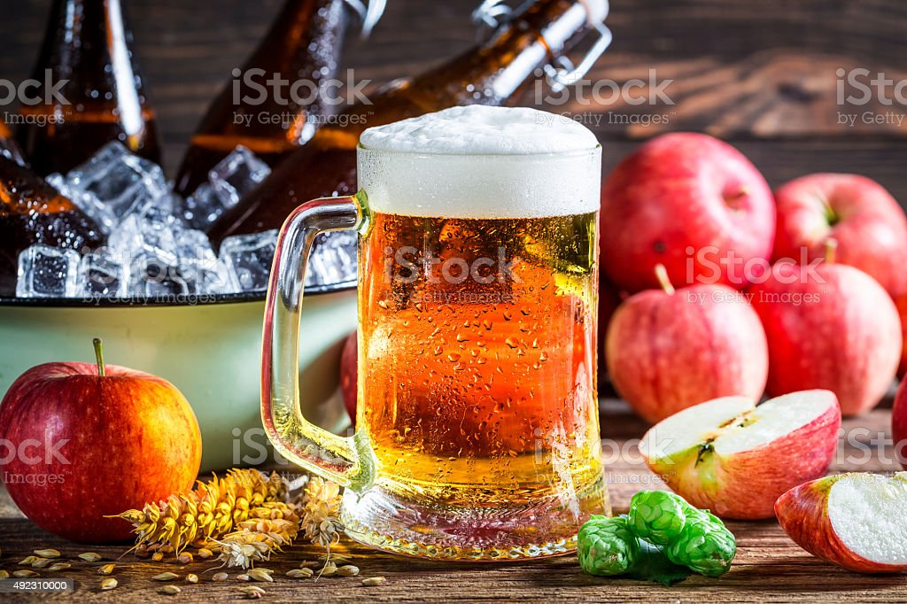 Cold and fresh cider beer with apples stock photo