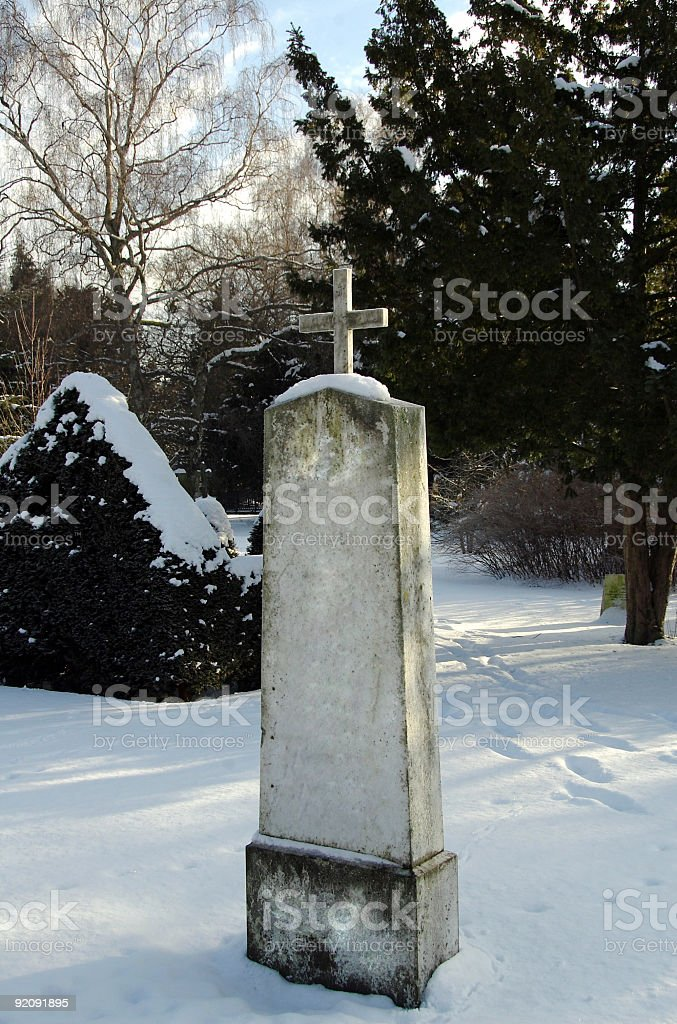 Cold and lonely Tombstone stock photo