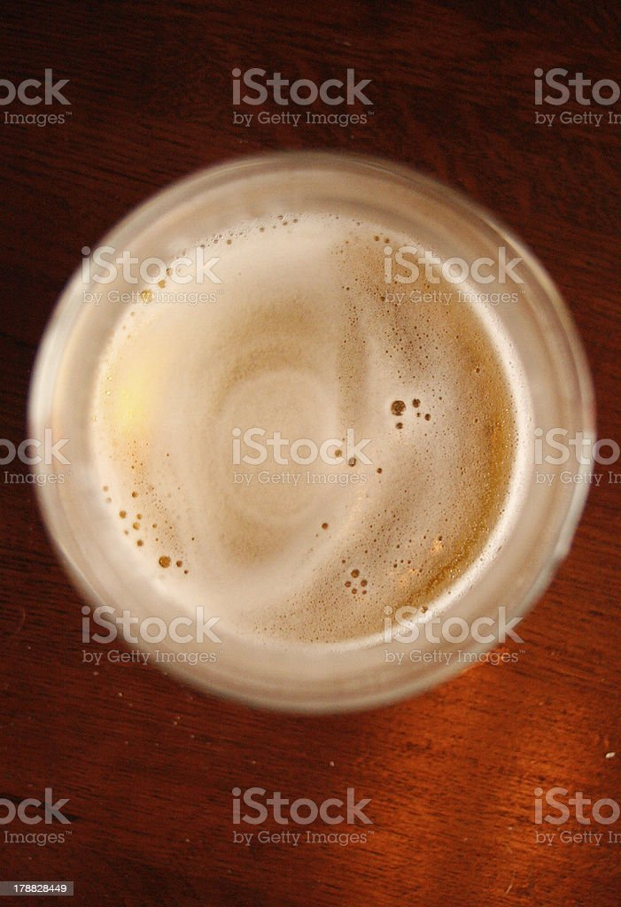 Cold beer froth on a wooden table royalty-free stock photo