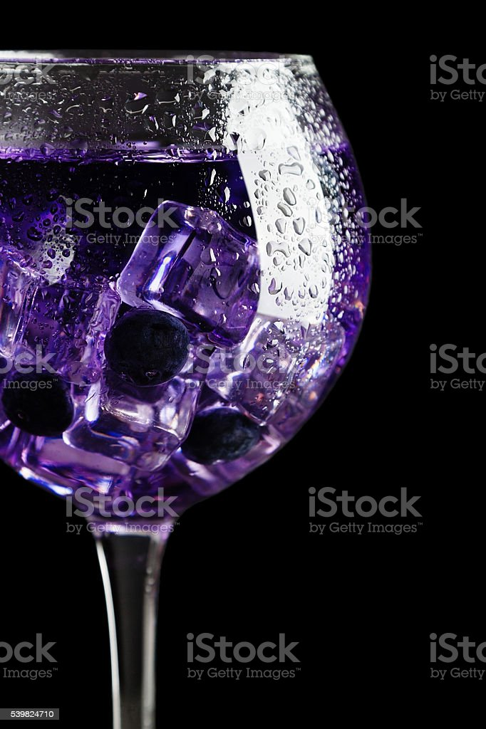 Cold blueberry drink with ice stock photo