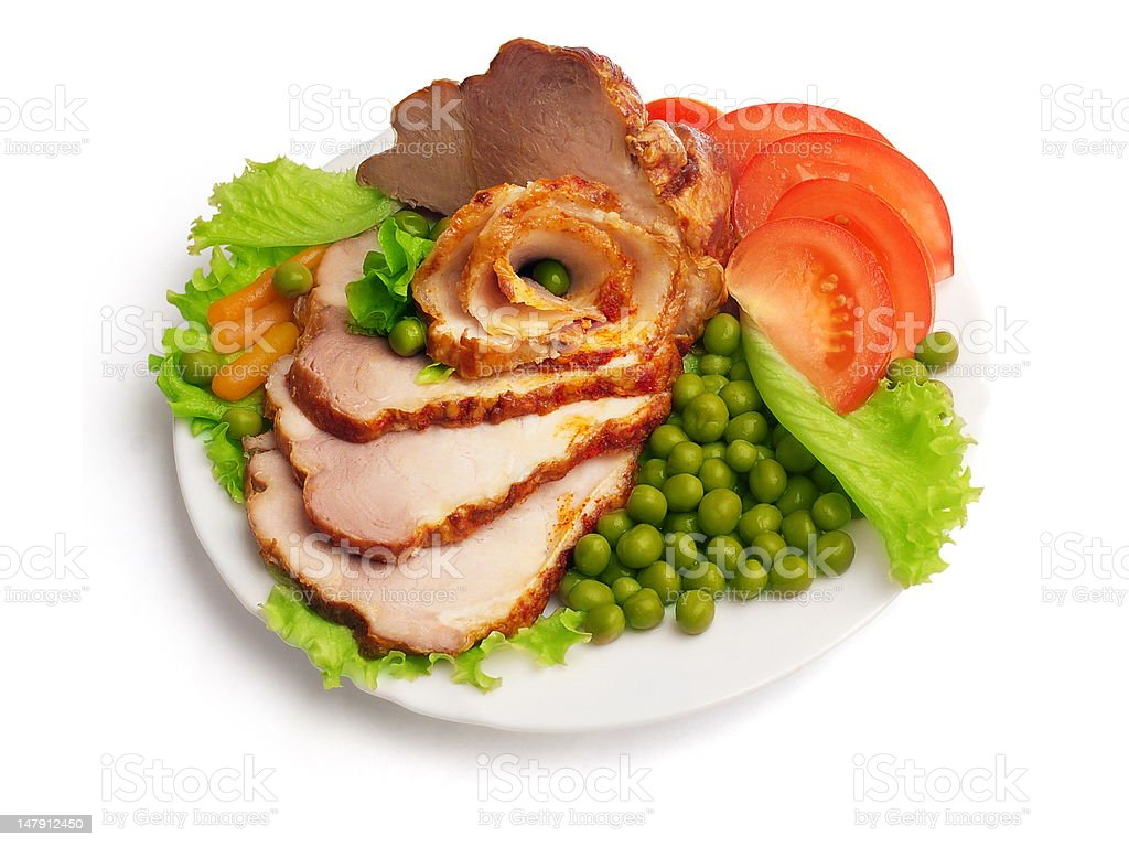 Cold boiled pork decorated with salad, tomatoes and green pea royalty-free stock photo