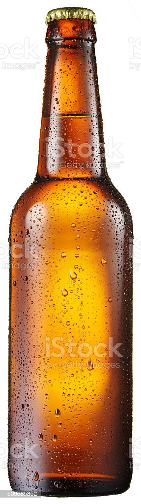Cold bottle of beer with condensated water drops on it. stock photo