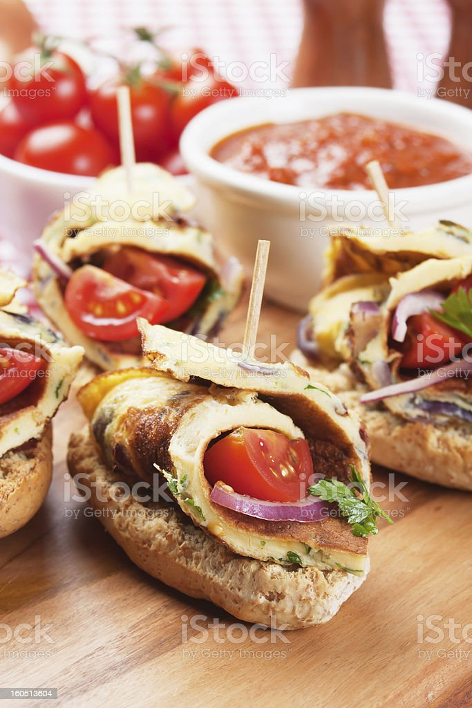 Cold buffet sandwich with omelete and cherry tomato royalty-free stock photo