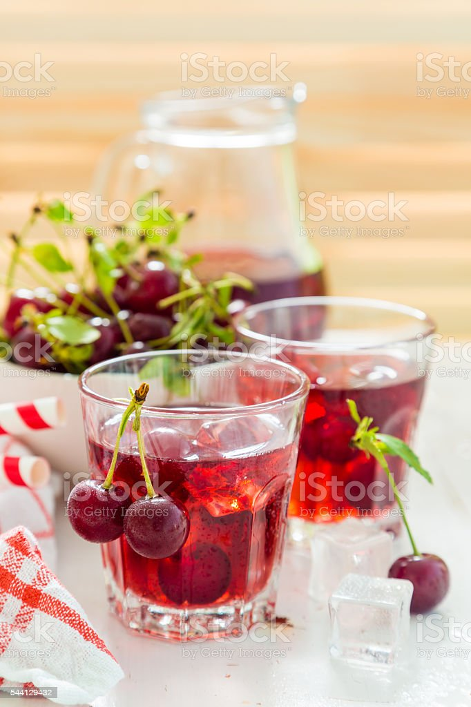 Cold cherry summer drink in glasses stock photo